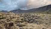 Never-ending Lava fields in Iceland with mountains