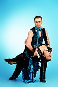 stock photo of tango  - Beautiful professional dancers perform tango dance with passion and expression - JPG