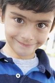 Close up of Hispanic boy smiling