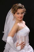Young dark blonde bride posing for the camera