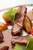 image of roast duck  - Breast of Duck with Roasted Potato Slice and Cherry Tomatoes - JPG