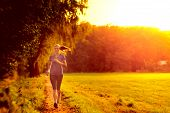 Young Woman Jogging Along A Country Track
