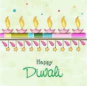 Colorful illuminated oil lit lamps on colorful abstract background for Happy Diwali celebrations.