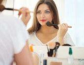 stock photo of blush  - Beauty woman applying makeup - JPG