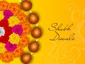image of rangoli  - Colorful half rangoli of flowers with five illuminated oil lit lamps and stylish text of Shubh Diwali on shiny yellow background - JPG