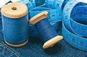 Meter And Spools Of Thread On Denim