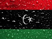 stock photo of libya  - a flag of Libya with rain drops - JPG