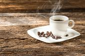 Warm Cup Of Coffee On Old Wooden Background