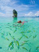 Woman swimming with snorkel, Andaman Sea, Thailand