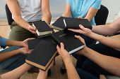 Group Of People Holding Holy Bible
