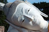 Face Of Outdoor Famous Reclining Buddha In Thailand.