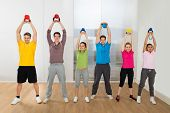 Multiethnic Friends Exercising With Kettle Bell
