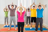 foto of yoga instructor  - Yoga Instructor And Students At Yoga Class  - JPG