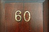 Number sixty on a door