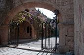 picture of filerimos  - Gated entrance to the Cloisters and Medieval Frescoes at Ialyssos monastery on the Greek island of Rhodes - JPG