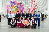 SHENZHEN, CHINA - FEBRUARY 16, 2015: China Southern Airlines crew members posing in airport. China Southern Airlines Company Limited is an airline headquartered in Guangzhou, Guangdong Province