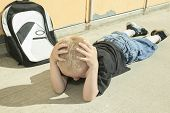 pic of playground school  - A very sad boy bullying in school playground - JPG