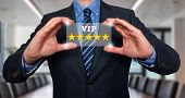 Businessman holds vip five stars in his hands- Stock Image