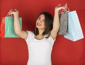 Happy Young Girl With Shopping Bags