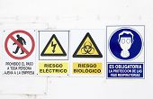 stock photo of hazardous  - hazard and danger signs on a wall - JPG
