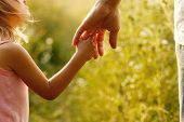 stock photo of father child  - a parent holds the hand of a small child - JPG