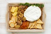 picture of cheese platter  - cheese platter on the white wooden background - JPG