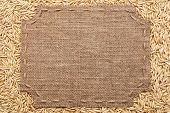 Figured Frame With Burlap And Stitches With  Place For Your Text Lying  On Oats Grains