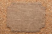 Figured Frame With Burlap And Stitches With  Place For Your Text Lying  On Wheat  Grains