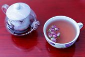 stock photo of kettles  - kettle and a cup of tea roses - JPG