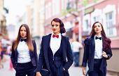 Gorgeous Women In Black Walking The City Street