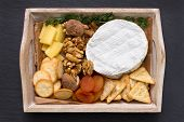 stock photo of cheese platter  - one cheese platter on the black background - JPG