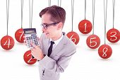 Geeky smiling businessman showing calculator against hanging red three