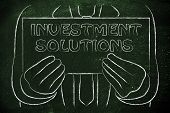 Business Man Holding Sign About Investment Solutions