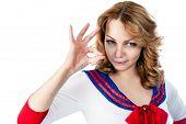 Pretty sailor shows ok gesture