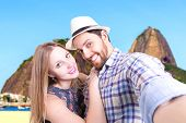 Beautiful couple taking a selfie photo in Rio de Janeiro, Brazil