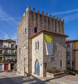 stock photo of dom  - The Medieval Tower of the Dom Pedro Pitoes Street in the city of Porto - JPG