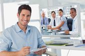 Business people brainstorming against handsome photo editor holding documents