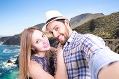 Beautiful couple taking a selfie photo in California, USA