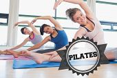 stock photo of pilates  - The word pilates and women stretching at yoga class against badge - JPG