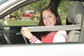 Car driver woman happy showing car keys out window
