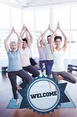 The word welcome and class standing in tree pose at yoga class against badge