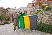 Man Looking Into Recycle Bin