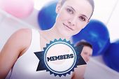 The word members and closeup portrait of woman at fitness studio against badge
