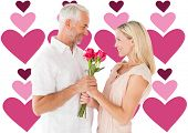 Affectionate man offering his partner roses against valentines day pattern