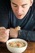 Man Eating Homemade Chicken Soup