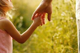 stock photo of finger  - a parent holds the hand of a small child - JPG