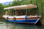 pic of dalyan  - Close up detailed side view of a boat in the river between Koycegiz Lake and Iztuzu Beach in Dalyan - JPG