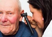 picture of hearing  - Audiologist checking elderly man - JPG