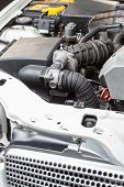 foto of muscle-car  - engine car in workshop for assistance in troubleshooting - JPG