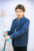 foto of preteen  - preteen handsome boy portrait on the white shabby wall background - JPG